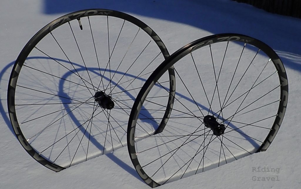 A set of Easton EA70 AX wheels in a snowy setting.