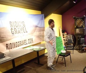 Man in hazmat suit at the Iowa Gravel Expo/Bike Party