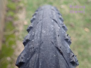 A close up of a mounted Tioga Binary tire