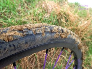 Image of a mud caked Binary tire
