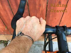 Grannygear's hand on the FSA KWING AGX handle bar