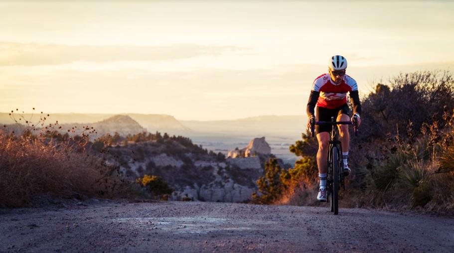 A lone rider cresting a hill.