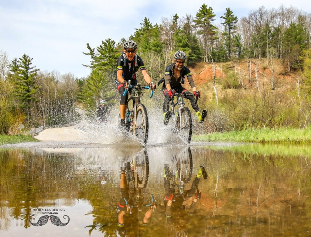 Image of cyclists splashing through water