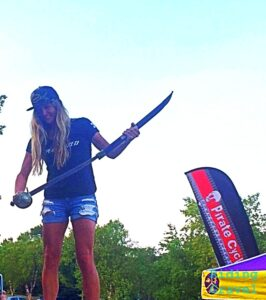 Allison Tetrick with pirate sword after winning the Gravel Worlds event