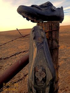 The RX8 gravel shoes on a fence post