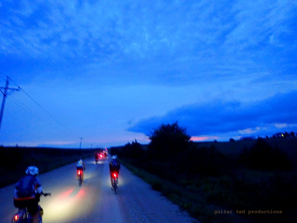 Riders on rural road at dawn
