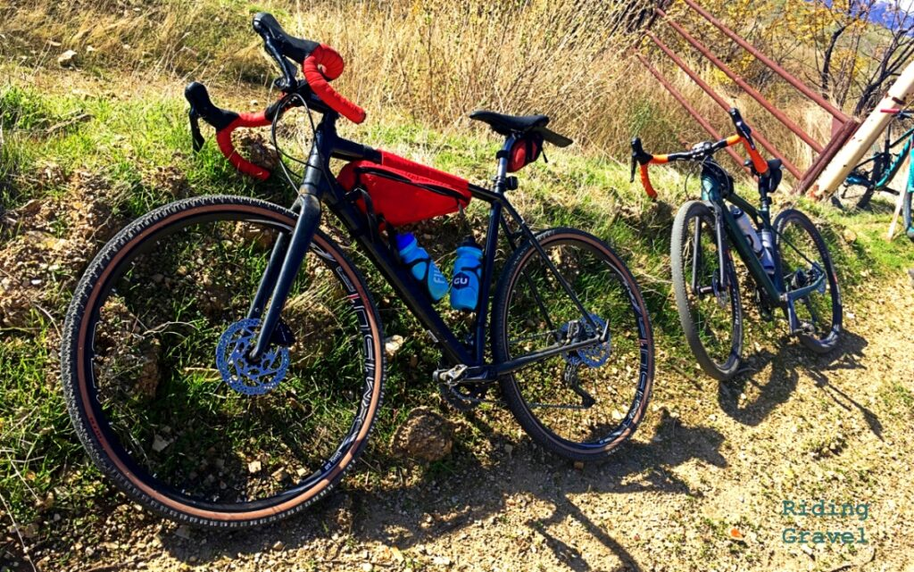 Two bicycles in a rural setting.